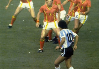 Diego Maradona In Front Of A Bunch Of Belgium Players